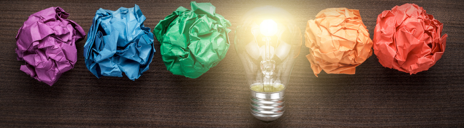 Lightbulb surrounded by crumpled paper